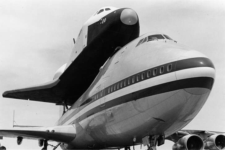 03/12/1978 - Space-shuttle orbiter Enterprise is shown mounted on a Boeing 747 that transports it, takes it aloft and releases it for the test flights. The orbiter was at Ellington AFB on a ferry stop to Marshall Space Flight Center in Huntsville, Alabama.  David  Nance / Houston Chronicle