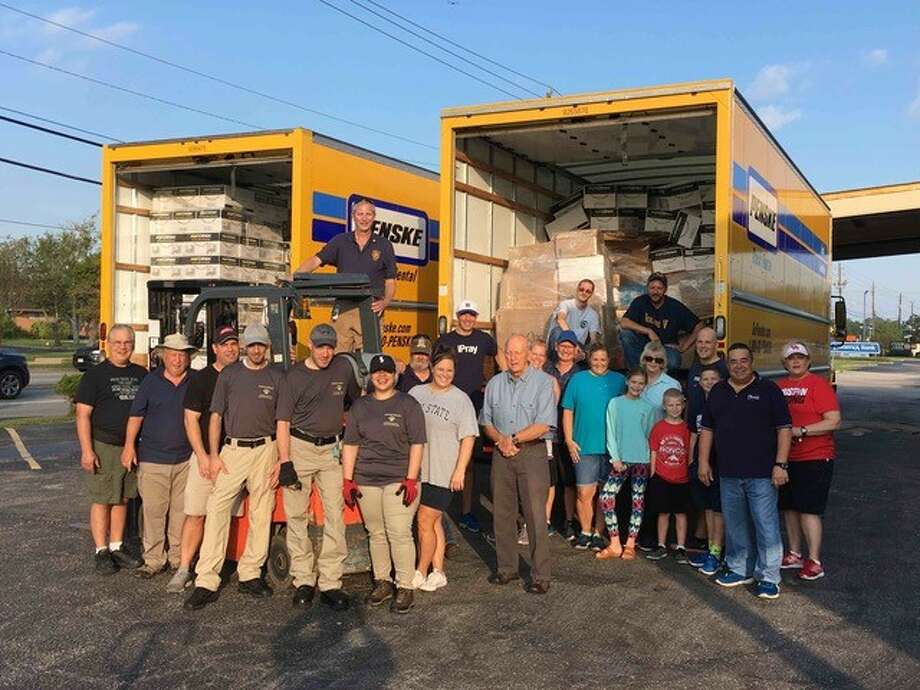 The Mission Team From Liberty New York Rotary Club, along with members of Operation Endeavor, with volunteers from Friendswood Rotary Club and the First Baptist Friendswood Church gather at the Friendswood distribution center. Also included are four drivers and two 30-foot box trucks donated by Rolling VBus Corp. local bus company.The trucks are  full of donated supplies from the collection drive to help those still in need from the devastation of Hurricane Harvey.