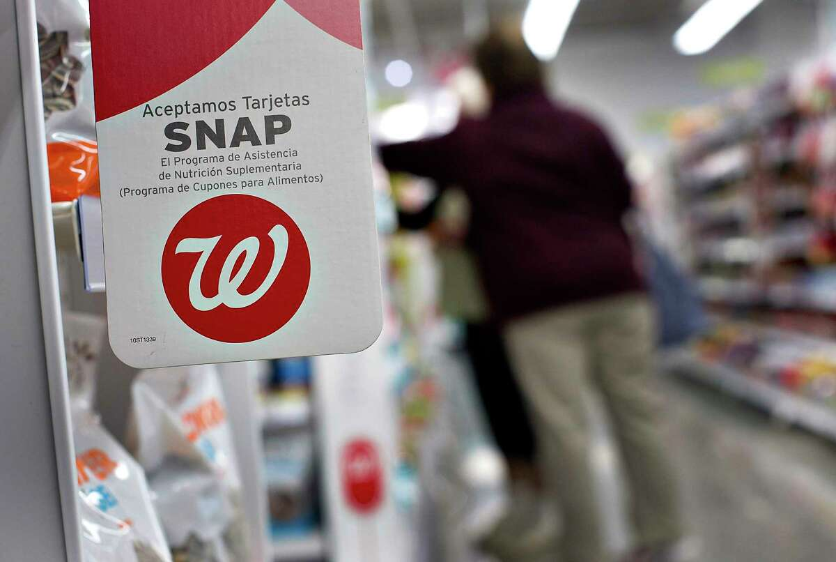 A sign advertising the acceptance of Supplemental Nutritional Assistance Program (SNAP) cards is displayed at a Walgreen Co. store in Chicago, Illinois, U.S., on Friday, March 23, 2012. Walgreen Co. is scheduled to release earnings data on March 27. Photographer: Daniel Acker/Bloomberg