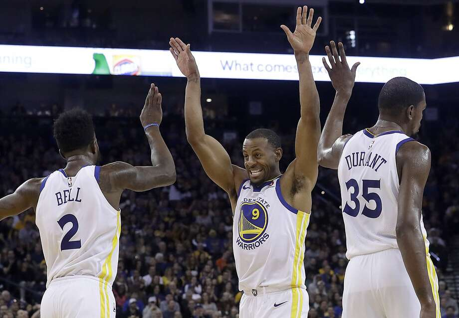 Golden State Warriors forwards Jordan Bell (2), Andre Iguodala (9) and Kevin Durant (35) celebrate during the second half of the team's NBA basketball game against the Utah Jazz in Oakland, Calif., Wednesday, Dec. 27, 2017. The Warriors won 126-101. (AP Photo/Jeff Chiu) Photo: Jeff Chiu, Associated Press