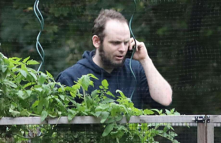 Canadian Joshua Boyle talks on the phone in October outside his family's home in Smiths Falls, Ontario. Boyle and his American wife were held captive by the Taliban for five years. Photo: MIKE CARROCCETTO, AFP/Getty Images
