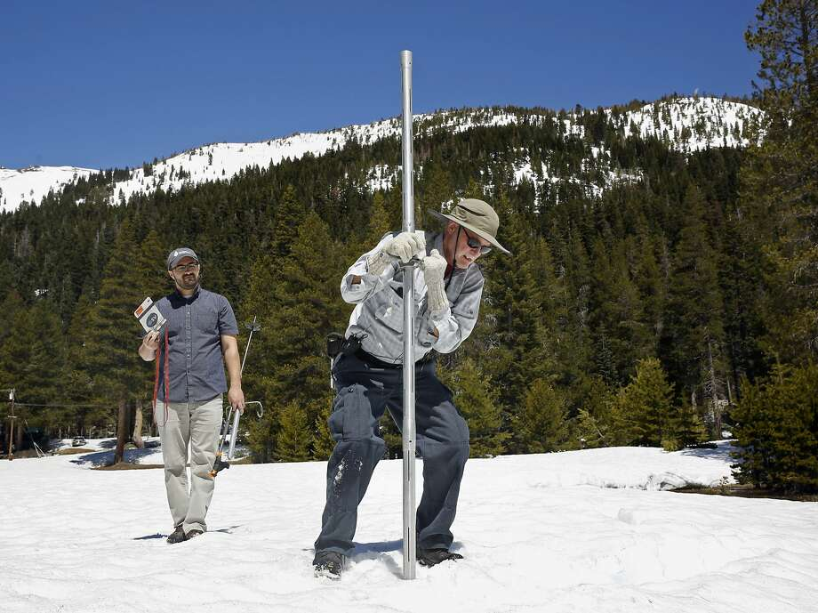 Frank Gehrke, chief of the California Cooperative Snow Surveys Program for the Department of Water Resources, right, plunges the snow survey tube into the snow pack, as DWR's Wes McCandless looks on. California's water managers are saying it's too early yet for fears that the state is sliding back into its historic five-year drought.  Photo: Rich Pedroncelli, Associated Press