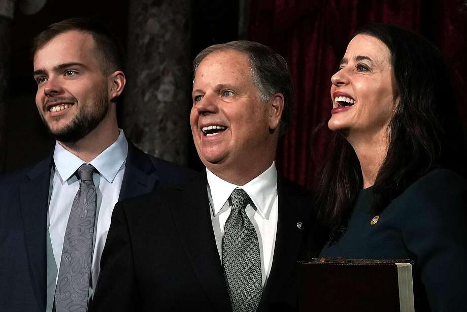 Alabama Sen. Doug Jones (2nd left) poses with his son Carson and wife Louise at the U.S. Capitol. Photo: Alex Wong, Getty Images