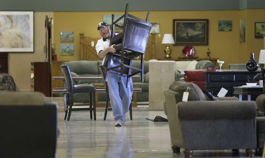 Brad Cain relocates items for sale at Furniture for a Cause in March of 2010. Cain lived at the SAMM Shelter and worked at the store which helped fund programs for the homeless. The store will be closing it's doors at the end of February, the victim of online sales. Photo: BOB OWEN /SAN ANTONIO EXPRESS-NEWS / SAN ANTONIO EXPRESS-NEWS
