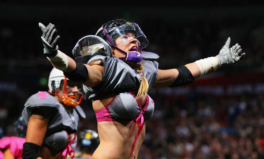 "SYDNEY, AUSTRALIA - JUNE 09:  Kyle DeHaven of the Eastern Conference ""NSW Blues"" celebrates scoring a touchdown during game two of the All-Star Lingerie Football League tour at Allphones Arena on June 9, 2012 in Sydney, Australia.  (Photo by Mark Kolbe/Getty Images)Browse through the photos for a look at what the LFL will bring to Houston.  Photo: Mark Kolbe/Getty Images"