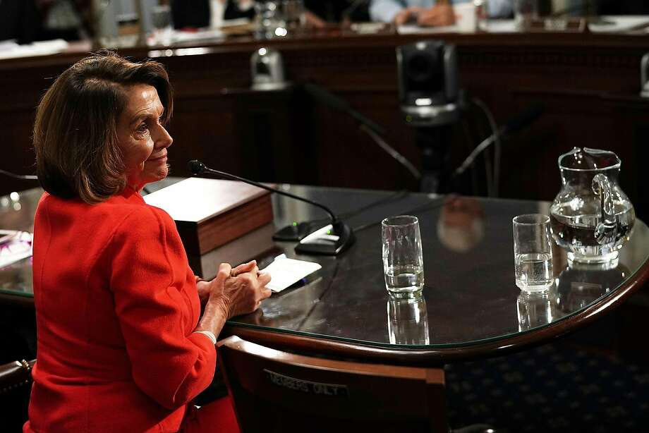 House Minority Leader Nancy Pelosi listens during a December meeting before the House Rules Committee at which she spoke about the Deferred Action for Childhood Arrivals policy. Photo: Alex Wong, Getty Images