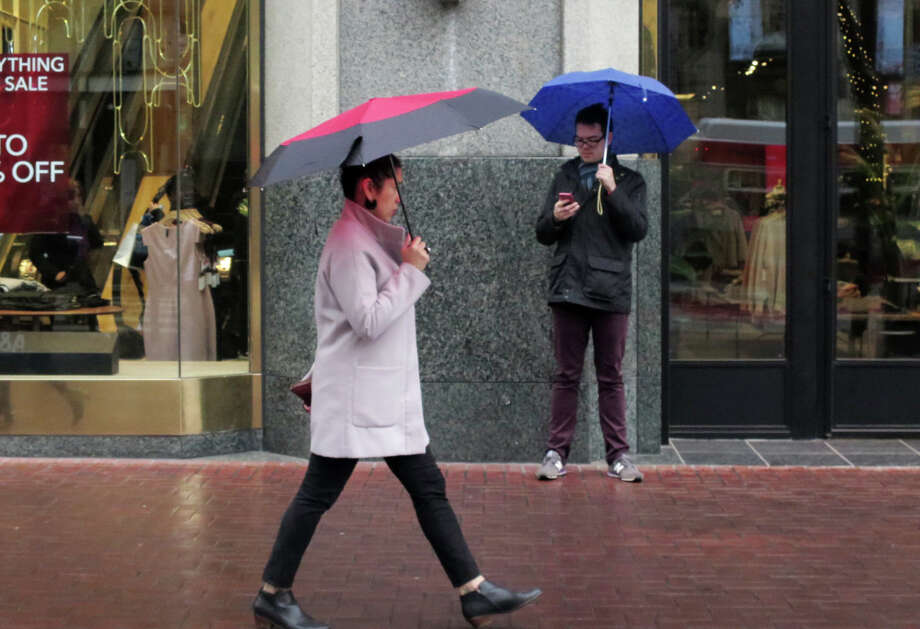 A series of storms are in the forecast for the Bay Area in the coming weak. Two are expected to be weak and one stronger. (Photo: A light rainfall fell over San Francisco on Wednesday, January 3, 2018.) Photo: Douglas Zimmerman / SFGate