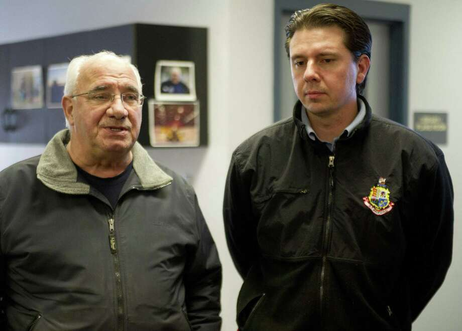 In this file photo, Director of Operations Ernie Orgera, left, and Traffic and Road Maintenance Supervisor Tom Turk, right, speak during a press conference at the city garage on Magee Avenue. Photo: Hearst Connecticut Media File Photo / Stamford Advocate
