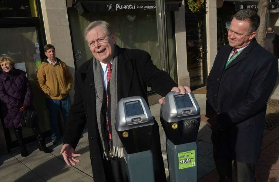 Mayor David Martin and Bureau Chief for Transportation Jim Travers announce the replacement of the old coin-op parking meters on Bedford Street with new digital meters Dec. 20 in downtown Stamford. Photo: Erik Trautmann / Hearst Connecticut Media / Norwalk Hour