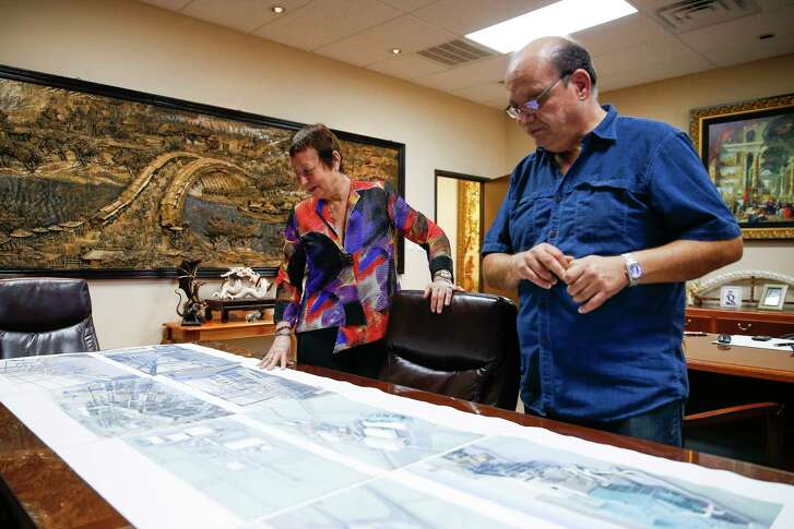 Gorham Group Industrial CEO Marlene Sarras, left, and project director Mario Monetta, right, look over plans for a fertilizer plant Friday, March 31, 2017 in Houston. Sarras relies on the H1B visa program to employ people, such as Monetta, to work on their specialized projects.