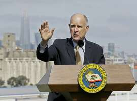 FILE - In this Sept. 29, 2017, file photo, California Gov. Jerry Brown speaks in San Francisco. Brown on Saturday, Dec. 23, 2017, announced pardons or sentence reductions for some 150 convicted criminals, including two Cambodian refugees facing deportation and a woman who has spent 33 years in prison despite a bungled plea deal that could have freed her decades ago. (AP Photo/Eric Risberg, File)