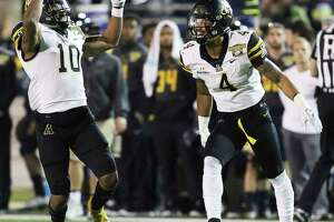 Appalachian State defensive back A.J. Howard (10) celebrates with Appalachian State defensive back Clifton Duck (4) after Clifton intercepted a pass from Toledo in the second half of the Dollar General Bowl NCAA college football game, Saturday, Dec. 23, 2017, in Mobile, Ala. (AP Photo/Dan Anderson)