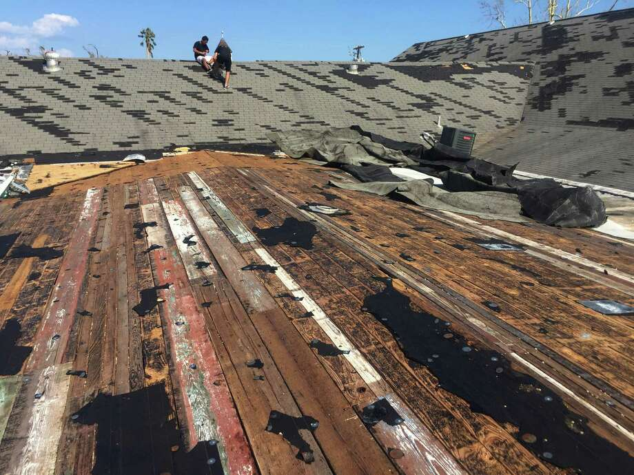 In this Aug. 30, 2017 photo, volunteers inspect damage to the roof of Rockport First Assembly of God Church in Rockport, Texas. The church, which was hit by Hurricane Harvey, has filed a lawsuit against the Federal Emergency Management Agency, challenging its policy of denying disaster aid to repair or rebuild places of worship. Places of worship are routinely denied FEMA aid when it comes time to repair and rebuild their damaged sanctuaries. (Photo Courtesy/Bruce Frazier via AP) Photo: Bruce Frazier, Associated Press / Bruce Frazier