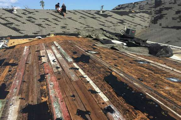 In this Aug. 30, 2017 photo, volunteers inspect damage to the roof of Rockport First Assembly of God Church in Rockport, Texas. The church, which was hit by Hurricane Harvey, has filed a lawsuit against the Federal Emergency Management Agency, challenging its policy of denying disaster aid to repair or rebuild places of worship. Places of worship are routinely denied FEMA aid when it comes time to repair and rebuild their damaged sanctuaries. (Photo Courtesy/Bruce Frazier via AP)