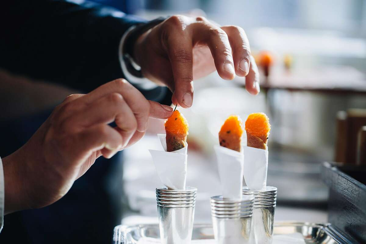 At the French Laundry, a chive is placed onto a salmon cornet. Thomas Keller includes many of the restaurant's recipes in his new cookbook.