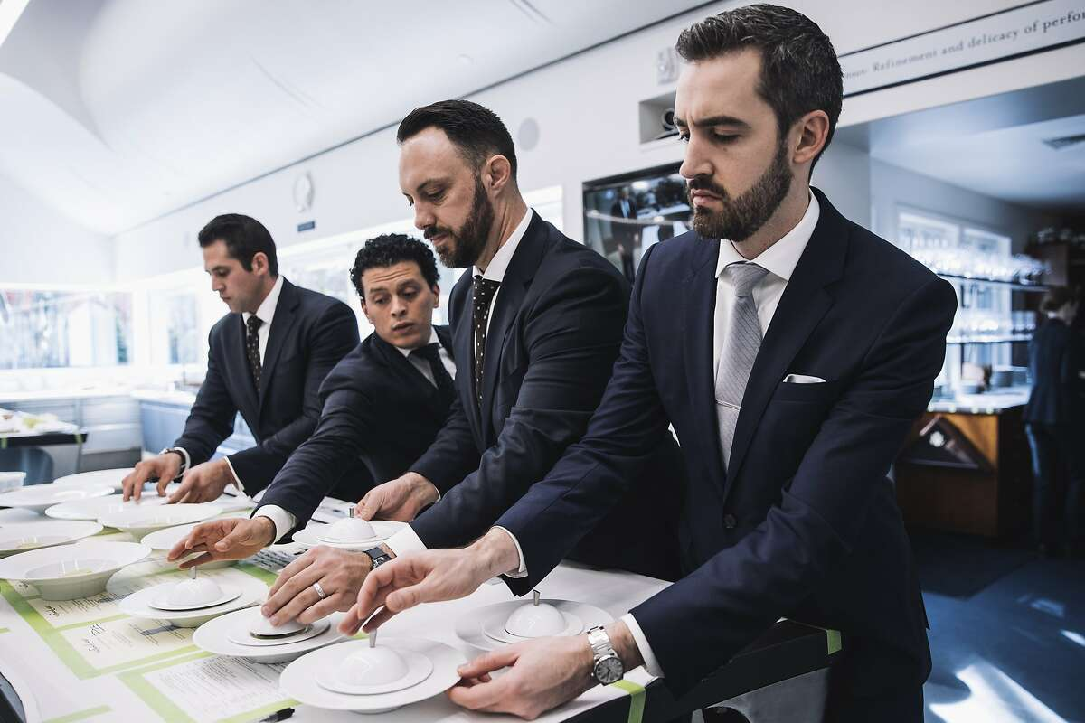 From left, Expeditor Garrett Hales, Back Server Emmanuel Lanuza, Coffee Server Todd Kendall and Maitre d?• Nick Fitch pick up a course at the newly remodeled French Laundry kitchen in Yountville, Calif. on Saturday, Dec. 9, 2017.
