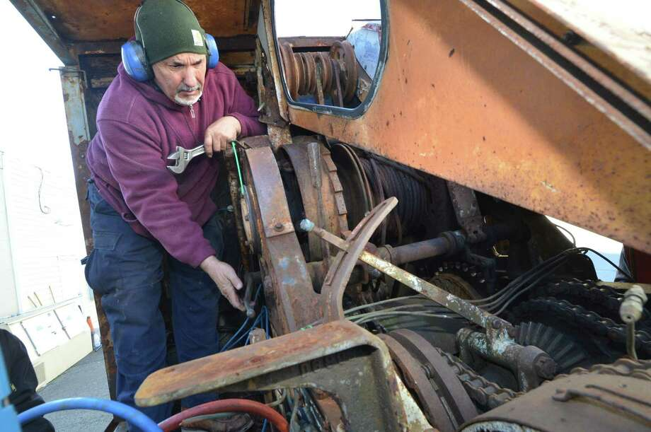 Rich Ruggles starts up the vintage Michigan crane as restorations efforts continue to bring it back to working order on Dec. 21  in Wilton  for the 2018 Memorial Day Parade . Photo: Alex Von Kleydorff / Hearst Connecticut Media / Norwalk Hour