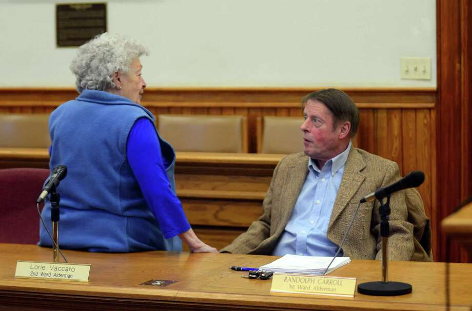 Former Aldermen Joan Radin and Randolph Carroll discuss matters during a 2017 board meeting. Carroll recently resigned from the board for undisclosed reasons following his election in November. Radin was defeated during the November elections. Photo: Christian Abraham / Hearst Connecticut Media / Connecticut Post