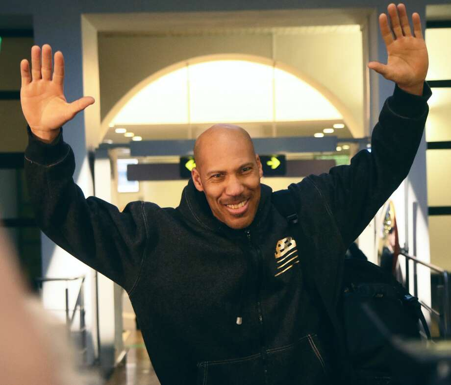 US entrepreneur LaVar Ball waves upon his arrival with his sons at Vilnius airport in Lithuania, on January 3, 2018, as the two teenagers arrive in the country to make their basketball pro career debut in the Lithuanian Vytautas club.  Basketball-crazed Lithuania welcomes LiAngelo and LaMelo Ball, the two youngest sons of flamboyant Los Angeles entrepreneur LaVar Ball who recently made headlines due to a feud with US President Donald Trump. / AFP PHOTO / Petras Malukas        (Photo credit should read PETRAS MALUKAS/AFP/Getty Images)Browse through the photos for more images from the Ball family's welcoming committee in Lithuania. Photo: PETRAS MALUKAS/AFP/Getty Images