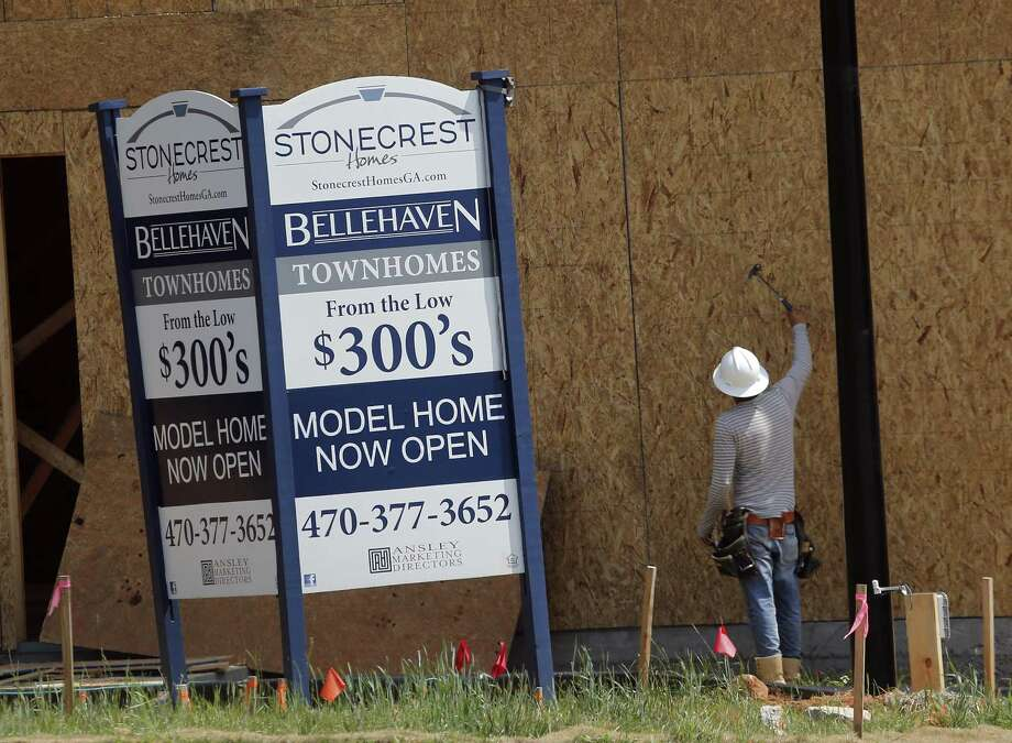 In this Tuesday, May 16, 2017, photo, a construction worker continues work on new town homes under construction in Woodstock, Ga. The new tax law has raised the possibility that homeownership may be losing some of its privileged status in American society, as the benefits of the mortgage interest and property tax deductions shrink. Those changes could dampen how attractive housing looks as an asset. Photo: John Bazemore /Associated Press / Copyright 2017 The Associated Press. All rights reserved.
