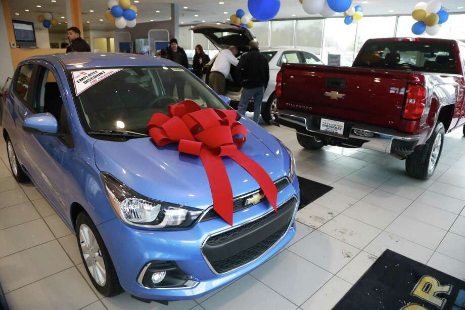 In a photo from Thursday, Dec. 28, 2017, people walk through the Taylor Chevrolet showroom in Taylor, Mich. At car dealerships, they call it the payment walk, when someone with a low credit score wants to buy a new car but gets walked to the used lot because they can't qualify for a new-car loan. As the Federal Reserve continues its string of interest rate increases, auto dealers and industry analysts say more people will be taking the walk because interest rates, and monthly payments are on the rise. Photo: Carlos Osorio /Associated Press / Copyright 2017 The Associated Press. All rights reserved.