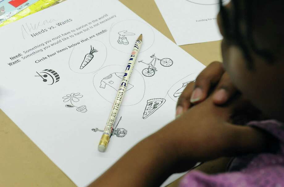 Despite its reputation as a hub for financial elites, Connecticut still isn't making the grade when it comes to financial literacy education, a new report shows. The state received an F for the third time on the biennial report by the Champlain College Center for Financial Literacy. Photo: Lori Van Buren / Albany Times Union / 10034383A