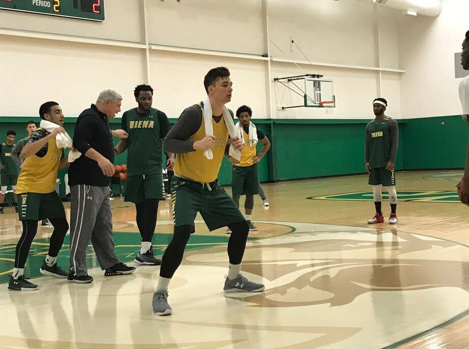 Siena junior forward Evan Fisher, who's third on the team with 45 personal fouls, uses a towel in a defensive drill. (Mark Singelais/Times Union)