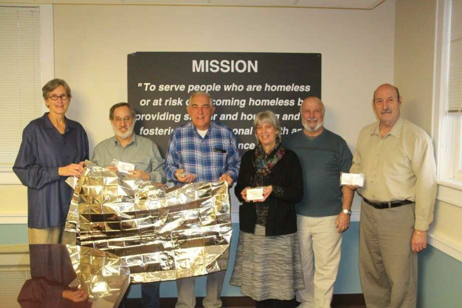 Probus Club of Greater New Haven recently donated 100 survival blanketpackages to Columbus House. Photo: Contributed
