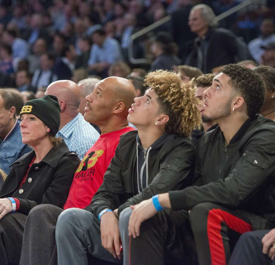 From left, Tina Ball, LaVar Ball, LaMelo Ball and LiAngelo Ball look on as the New York Knicks welcome the Los Angeles Lakers to Madison Square Garden in New York on Tuesday, Dec. 12, 2017. (Howard Simmons/New York Daily News/TNS) Photo: Howard Simmons, TNS
