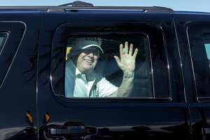 President Donald Trump waves to supporters from his motorcade traveling to Mar-a-Lago from Trump International Golf Club, on Thursday, Dec. 28, 2017, in West Palm Beach, Fla. (Greg Lovett/Palm Beach Post/Zuma Press/TNS)