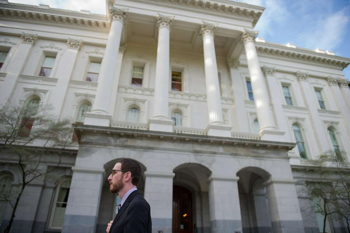 FILE-- Sen. Scott Wiener, D-San Francisco, walks to the state Capitol in Sacramento, Calif. on Thursday, March 16, 2017.