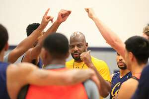 Cal Golden Bears men's head basketball coach Wyking Jones talks with players at the end of practice at the UC Berkeley Recreational Sports Facility on Wednesday, November 8,  2017 in Berkeley, Calif.