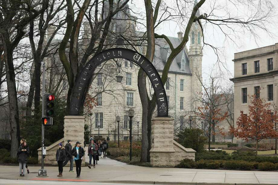 University and college educations are becoming increasingly crucial to getting and keeping jobs, but Republicans are concluding that colleges are liberal bastions brainwashing their children. Here, an entrance to Northwestern University in Chicago is shown. Photo: Chris Walker /TNS / Chicago Tribune