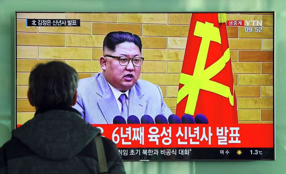 A man watches a television news broadcast showing North Korean leader Kim Jong-Un's New Year's speech, at a railway station in Seoul on Monday. North Korean leader Kim Jong-Un said he was always within reach of the nuclear button in a defiant New Year message after months of escalating tensions over his country's weapons program. Photo: JUNG YEON-JE /AFP /Getty Images / AFP or licensors