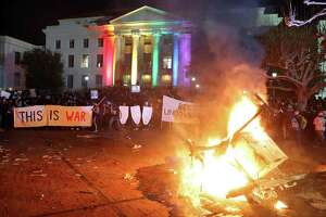 A portable light unit burns after protesters forced the cancellation of a talk by right-wing speaker Milo Yiannopoulos at the University of California, Berkeley on Feb. 1. Tribalism has become most pronounced on college campuses.