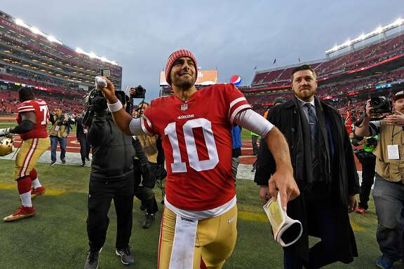 San Francisco 49ers quarterback Jimmy Garoppolo (10) tosses his wristbands into the stands as he walks off the field after defeating the Jacksonville Jaguars, 44-33, at Levi's Stadium in Santa Clara, Calif., on December 24, 2017. (Jose Carlos Fajardo/Bay Area News Group/TNS)
