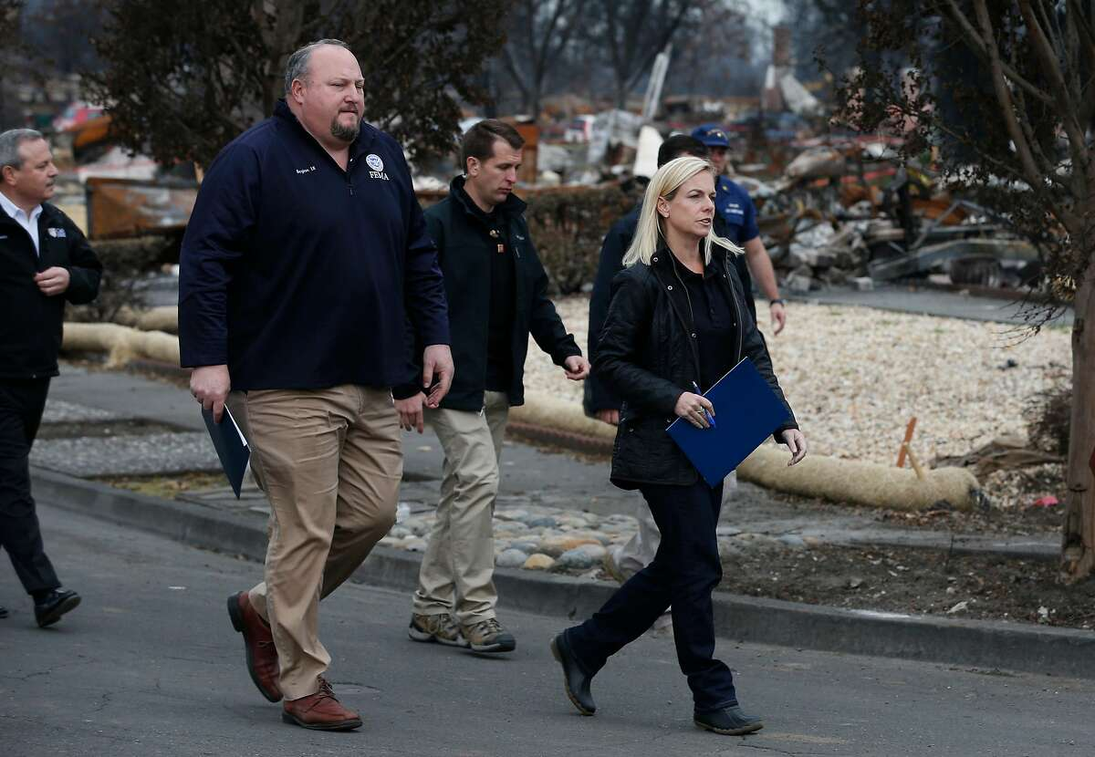Kirstjen Nielsen, Secretary of the Department of Homeland Security, walks on View Court with FEMA regional director Bob Fenton (left) while touring the Coffey Park neighborhood destroyed in the Tubbs Fire in Santa Rosa, Calif. on Wednesday, Jan. 3, 2018.