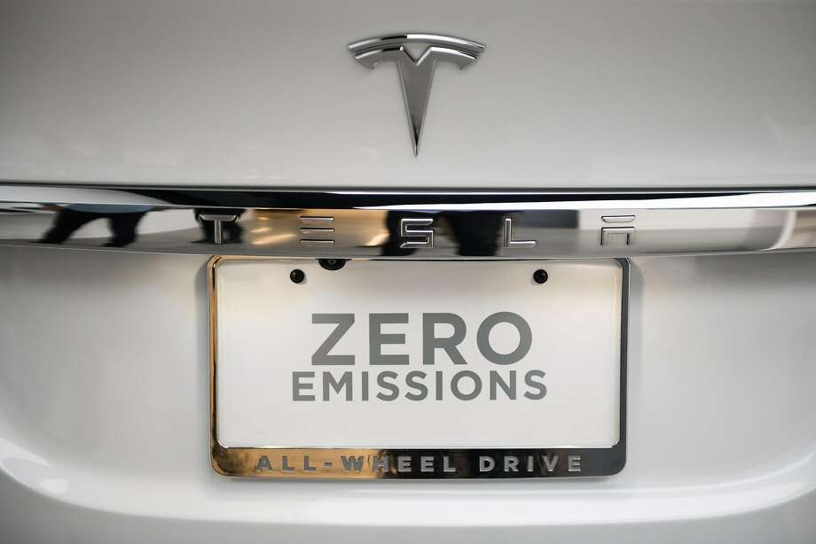 """A """"Zero Emissions"""" tag is seen on the rear of a Tesla Inc. Model X P100D sports utility vehicle (SUV) at the company's new showroom in New York, U.S., on Thursday, Dec. 14, 2017. The Meatpacking District location, which opens to the public at 11 a.m. Friday, lets customers for the first time explore energy offerings, configure cars and place orders all under one roof. Photographer: Mark Kauzlarich/Bloomberg Photo: Mark Kauzlarich, Bloomberg"""