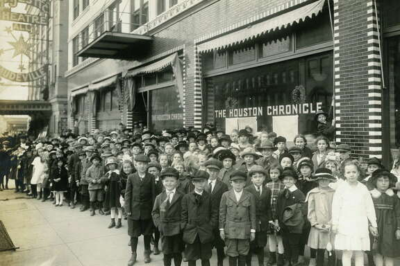 Jan 4, 1918 - 400 pupils from the Harvard School, Houston Heights, stand outside the Houston Chronicle building and the Majestic Theatre in downtown Houston.