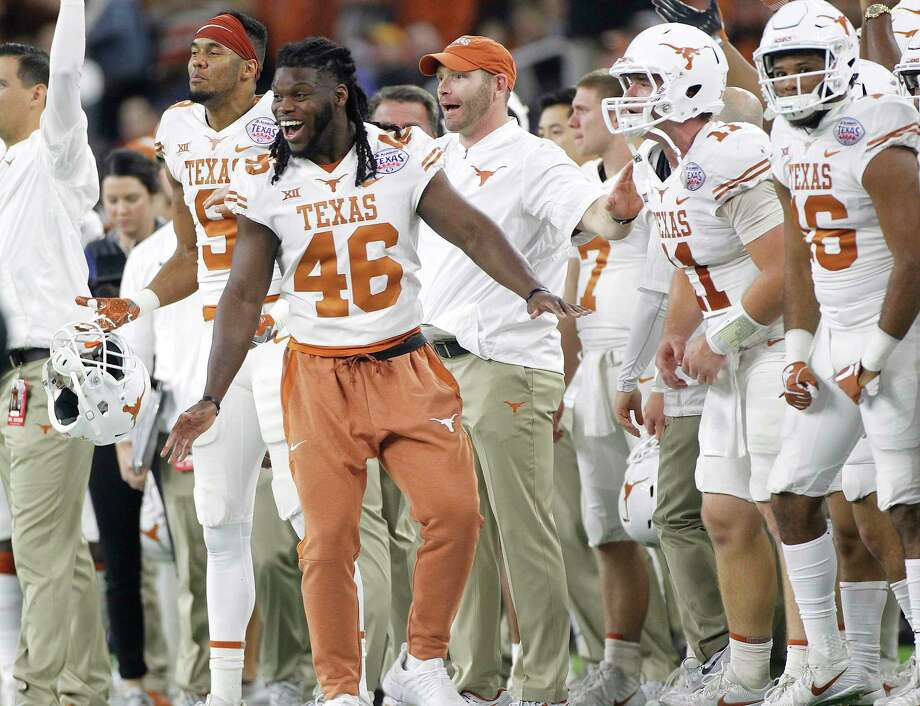 Texas Longhorns linebacker Malik Jefferson (46) celebrates on the sidelines during the final minute of the team's 33-16 win over Missouri Tigers at NRG Stadium on Thursday, Dec. 28, 2017, in Houston. Texas won the game 33-16. ( Elizabeth Conley / Houston Chronicle ) Photo: Elizabeth Conley, Chronicle / © 2017 Houston Chronicle