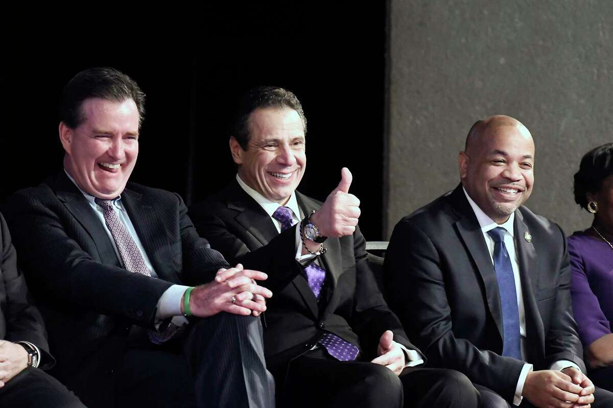 New York Gov. Andrew Cuomo, center, is flanked by Senate Majority Leader John Flanagan, R-Smithtown, left, and Assembly Speaker Carl Heastie, D-Bronx, right, as he wits to deliver his State of the State address at the Empire State Plaza Convention Center on Wednesday, Jan. 3, 2018, in Albany, N.Y. (AP Photo/Hans Pennink)