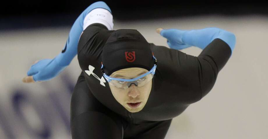 Fourth-place finisher Jonathan Garcia competes in the men's 1,000 meters during the U.S. Olympic speedskating trials on Sunday, Dec. 29, 2013, in Kearns, Utah. (AP Photo/Rick Bowmer) Photo: Rick Bowmer/Associated Press