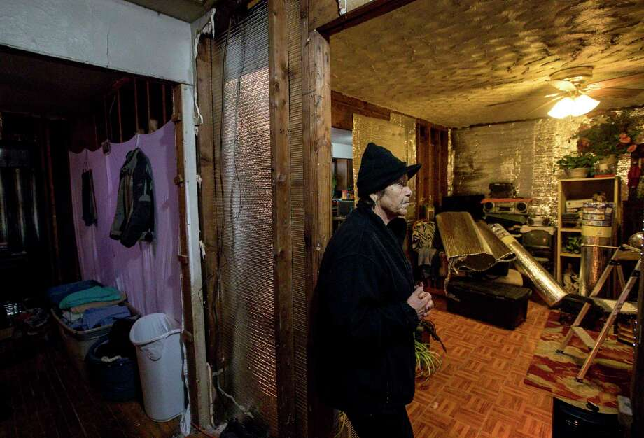 Paula Castro, 66, pauses while talking about the process of rebuilding after Hurricane Harvey brought several feet of water into her home, Wednesday, Jan. 3, 2018, in Houston. Castro's son put up temporary insulation in the home to help her deal with freezing temperatures during the previous few nights. Castro said an error in her application for FEMA aid kept her from getting enough money to repair more of her home.  ( Jon Shapley / Houston Chronicle ) Photo: Jon Shapley, Staff Photographer / © 2017 Houston Chronicle
