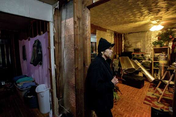 Paula Castro, 66, pauses while talking about the process of rebuilding after Hurricane Harvey brought several feet of water into her home, Wednesday, Jan. 3, 2018, in Houston. Castro's son put up temporary insulation in the home to help her deal with freezing temperatures during the previous few nights. Castro said an error in her application for FEMA aid kept her from getting enough money to repair more of her home.  ( Jon Shapley / Houston Chronicle )