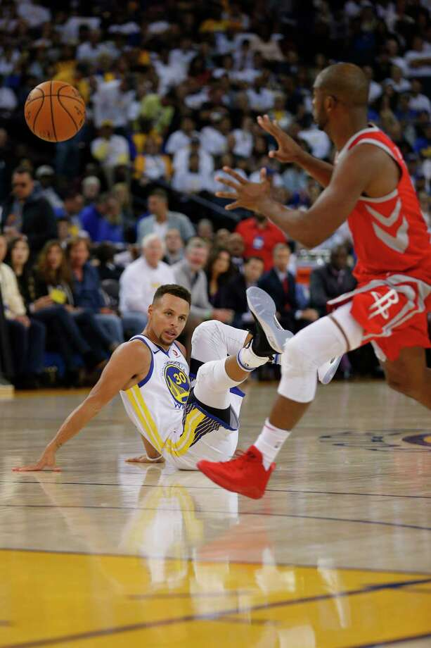 PHOTOS: Rockets game-by-gameGolden State Warriors guard Stephen Curry (30) loses his balance as Houston Rockets guard Chris Paul (3) drives to the basket during the third quarter of an NBA game between the Golden State Warriors and the Houston Rockets at Oracle Arena on Tuesday, Oct. 17, 2017, in Oakland, Calif. The Warriors lost the basketball game 122-121.Browse through the photos to see how the Rockets have fared through each game this season. Photo: Santiago Mejia, Staff / ONLINE_YES