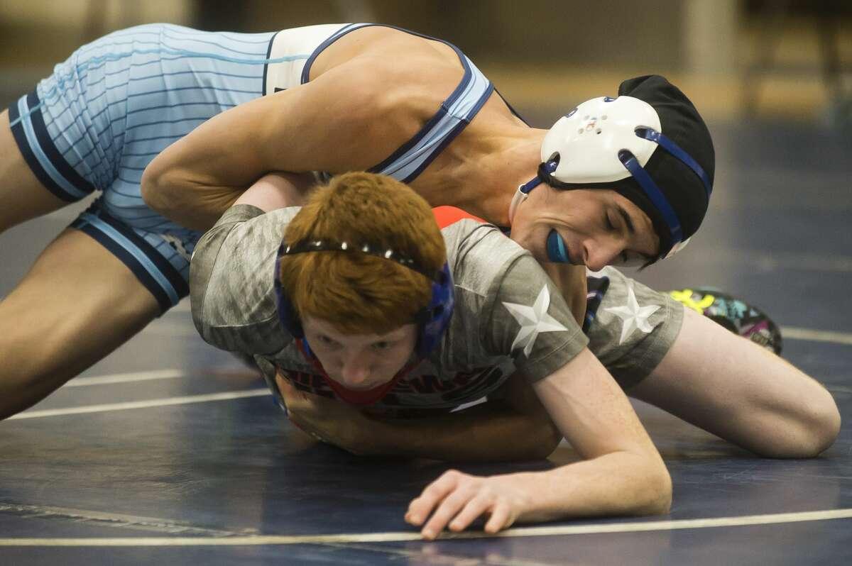 Meridian's Travis McDonald, top, wrestles Chippewa Hills' Logan Hansen on Wednesday, Jan. 3, 2018 at Meridian High School. (Katy Kildee/kkildee@mdn.net)