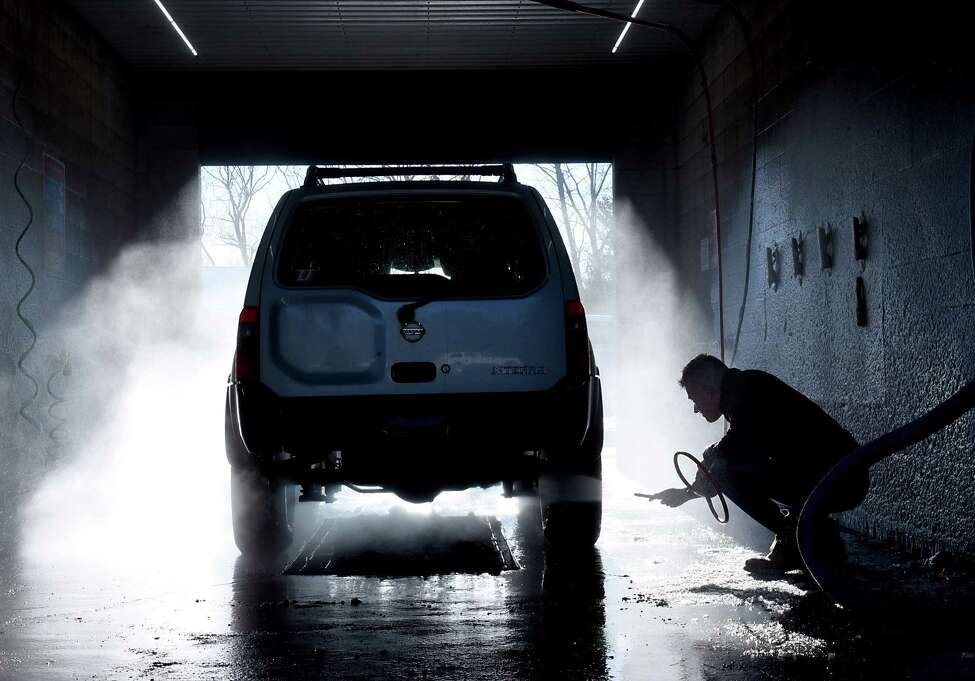 Brett Reihs of Guilderland washes his car at Colonial Car Wash on Western Ave. on Wednesday, Jan. 3, 2018 in Guilderland, N.Y. (Lori Van Buren / Times Union)