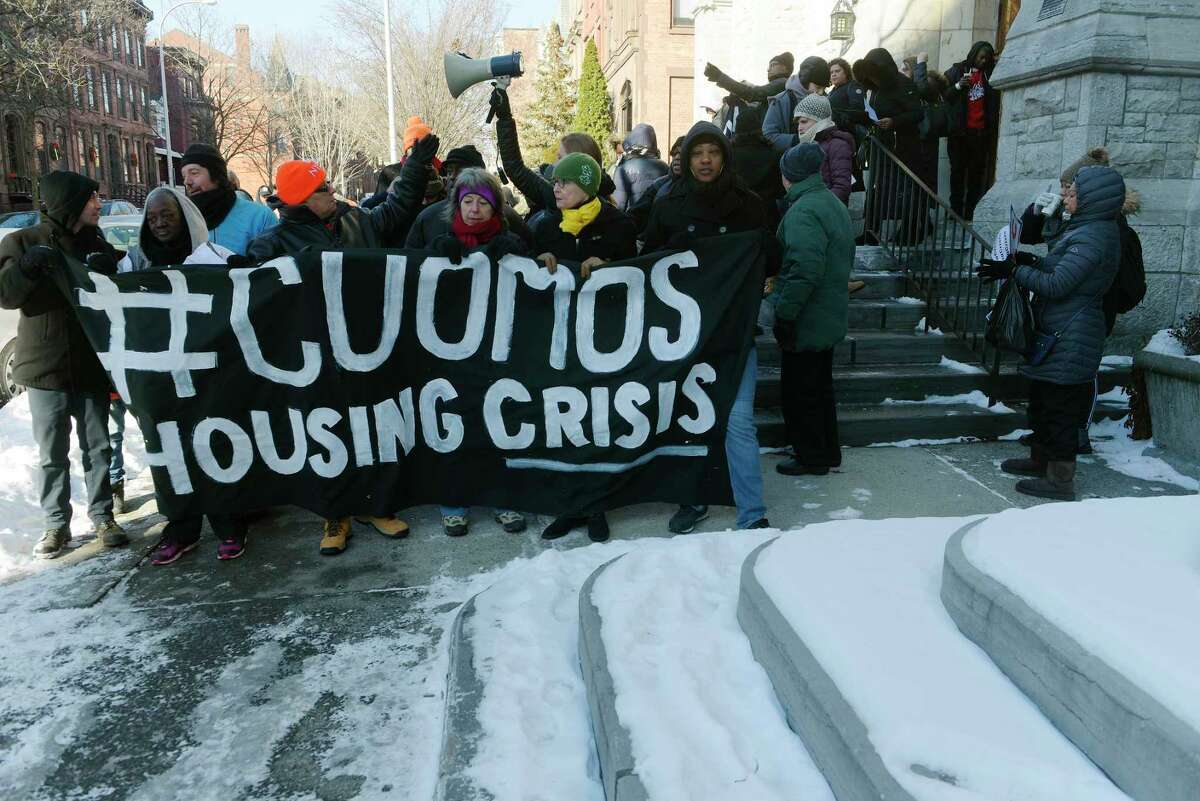 Tenants and housing advocates from across New York take part in a march along State Street on their way to the Capitol on Wednesday, Jan. 3, 2108, in Albany, N.Y. Those taking part in the protest are upset over what they say our Governor Andrew Cuomo's failed housing policies. The group was calling for immediate action from the Governor on rising rents, bad living conditions, increased homelessness and landlord harassment. The march was organized by the group Housing Justice for All. (Paul Buckowski / Times Union)