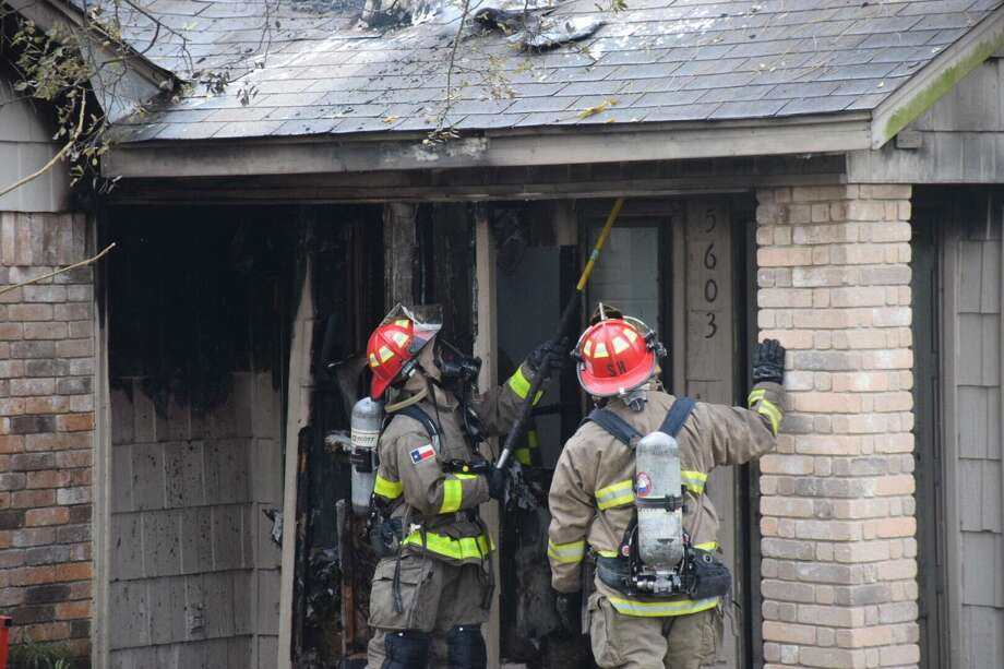 A fireplace blaze caused $100,000 in damage to a Northeast Side home on Jan. 1. Photo: Caleb Downs /San Antonio Express-News / San Antonio Express-News