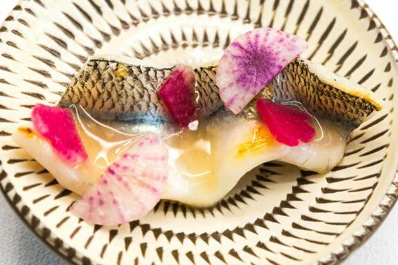 Charcoal grilled needlefish with Navarin glaze and garden radishes photographed at The French Laundry in Yountville, Calif. on Saturday, Dec. 9, 2017.